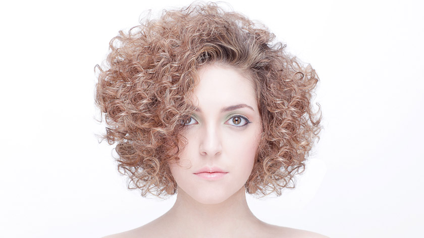 Lesson 4 of the Curls and Texture online haircutting course - Triangular Layering